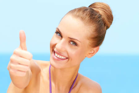 Portrait of happy woman with thumb up gesture Stock Photo - 13106470