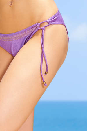 tantalising: Sexy female body part at the exotic beach Stock Photo