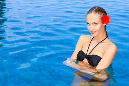 sexual health: Gorgeous young woman standing in swimming pool Stock Photo