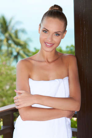 unspoilt: Beautiful ,  smiling woman wrapped in white bath towel Stock Photo