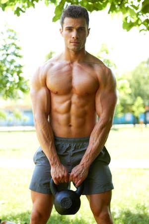 Handsome man during workout in park Banco de Imagens