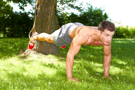 Fitness man doing push ups in the park Stock Photo - 13891133