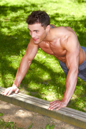 well build: Well build man train in park at summer time Stock Photo