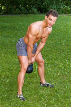 muscle guy: Handsome man Doing exercises with weight Stock Photo