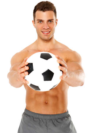 fit ball: Happy muscular young man holding soccer ball over white background