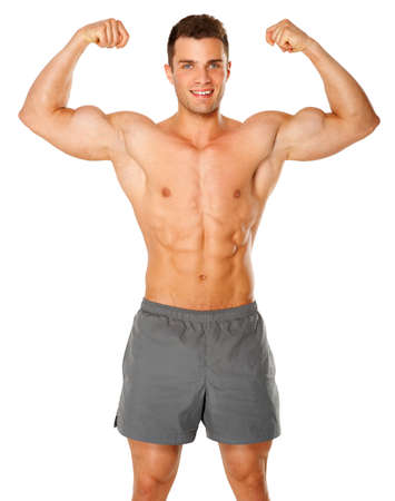白い背景の上に彼の上腕二頭筋を屈曲フィットと筋肉の男
