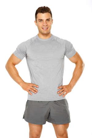 hombre fuerte: Saludable hombre musculoso joven aislado en fondo blanco