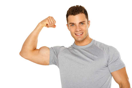 Handsome muscular young man isolated on white background photo
