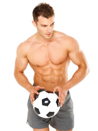 Handsome man holding soccer ball on white background