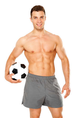 Sporty man holding foot ball on white background