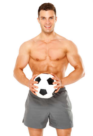 Fit muscular man with soccer ball on white background Stock Photo - 14037061