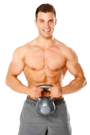 Fit muscular man exercising with dumbbell on white background photo