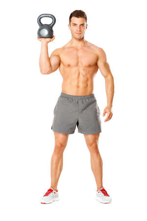 fit body: Handsome man working with kettlebell on white background