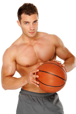 male chest: Portrait of a young man holding the ball tightly against white background