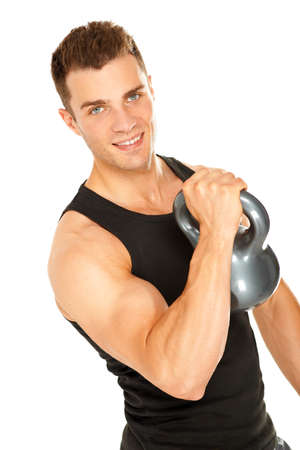 Muscular man lifting dumbbell and looking in camera on white background photo