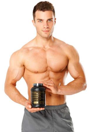 hombres musculosos: Hombre musculoso sosteniendo el recipiente negro de los suplementos de formaci�n