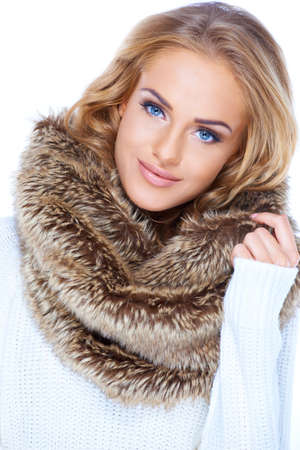Gorgeous blond woman wearing winter fur scarf and smiling photo