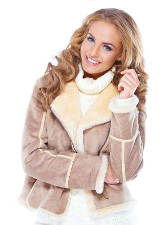 Cute woman wearing modern winter fur jacket , isolated Foto de archivo