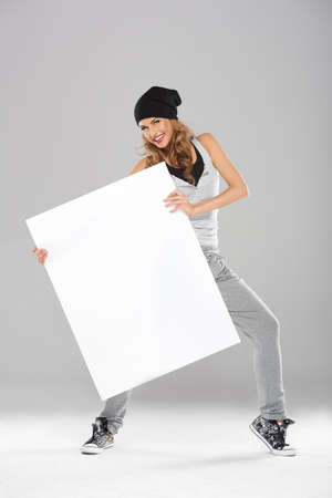 advertisment: Young fashionable modern dancer holding white empty board Stock Photo