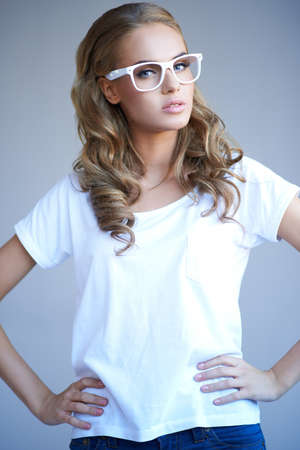 Portrait of a lovely young girl wearing stylish white glasses