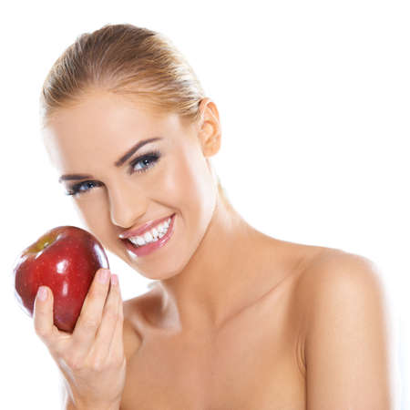 Cute young lady holding red apple while isolated on white photo