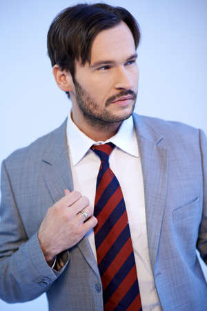 Portrait of a handsome Caucasian young beard man wearing suit and necktie Stock Photo - 17221042