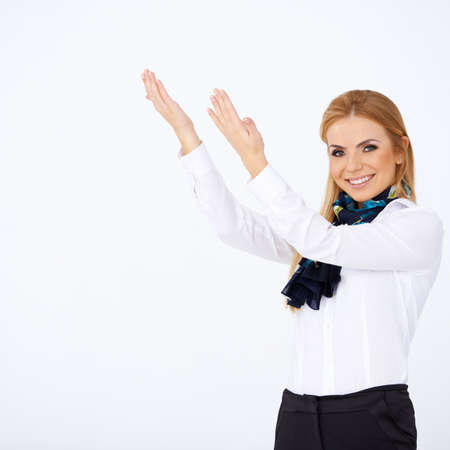Pretty blond stewardess dressed in uniform and smiling. White background Stock Photo - 17366524