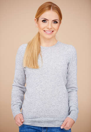 Casual blond girl smiling and looking at camera in relaxed clothing Stock Photo - 17541017