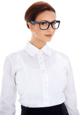 Beautiful smart professional businesswoman in glasses and a plain white blouse giving lending her a rather severe scholastic appearance isolated on white