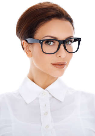 hair tied: Portrait of a beautiful professional brunette woman with her hair tied back neatly in modern black framed glasses isolated on white