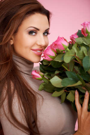 busty: Beautiful seductive woman with a large bouquet of romantic pink roses for Valentines Day Stock Photo