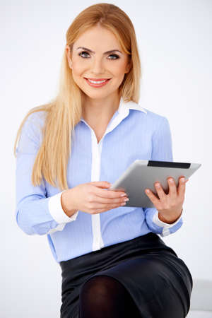 Portrait of blond girl holding a tablet and smiling. Isolated on white Stock Photo - 17968814