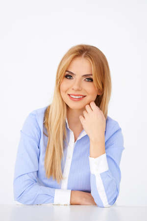 Portrait of apretty blond girl, smiling at camera. White background Stock Photo - 17968799