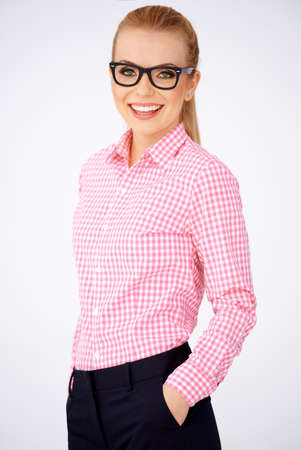 Portrait of a happy blonde geek girl wearing pink shirt and smart glasses Stock Photo - 17968807