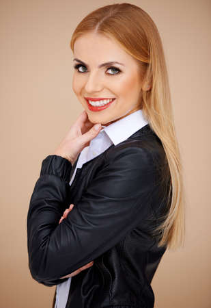 Portrait of a smiling blonde, looking at camera. Side view Stock Photo - 17968929