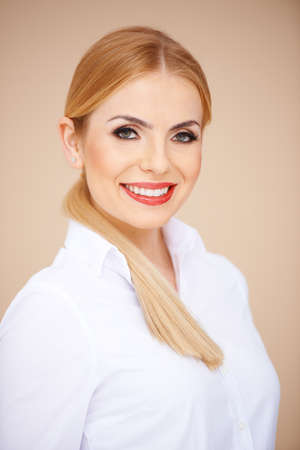 Portrait of a blond girl in a white blouse, looking at camera Stock Photo - 17968885