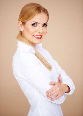 Side view of a blond girl smiling and looking at camera Stock Photo - 17968809