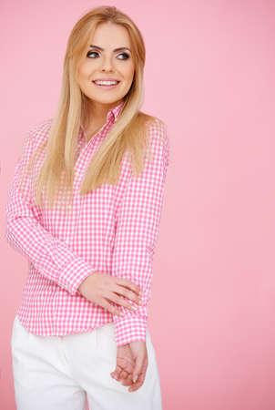 Blond girl in pink, standing full-length body shot in elegant blouse photo