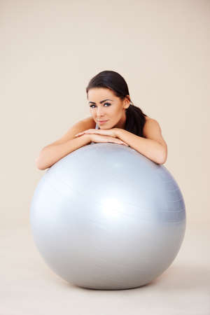 fit ball: Woman relaxing after exercises with fitness ball Stock Photo