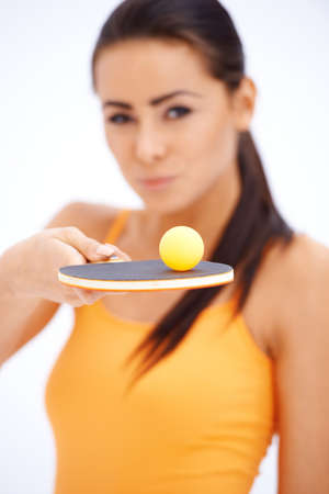 Sporty table tennis player with holding rocket and balancing ball photo