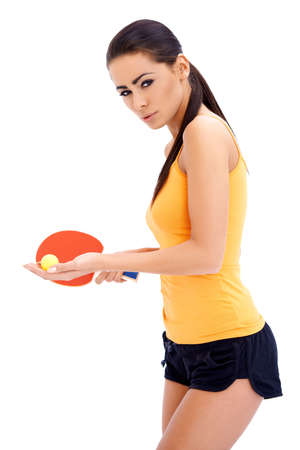 Female table tennis player is ready to serve a ball photo