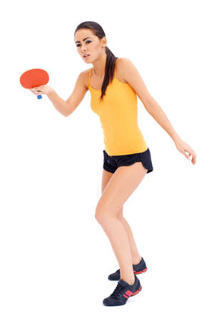 girl in sportswear: Female table tennis player is ready to serve a ball Stock Photo