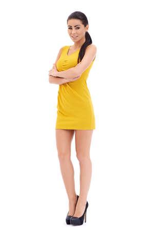 miniskirt: Playful beautiful leggy model posing on white, full body studio portrait Stock Photo
