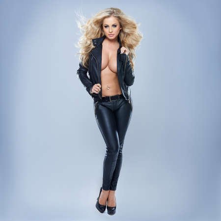 Sexy Blonde Woman Wearing Jacket On Blue Background Stockfoto