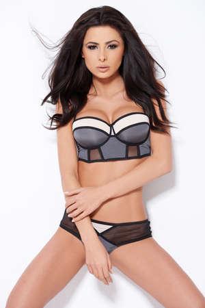 Adorable brunette posing on white background photo