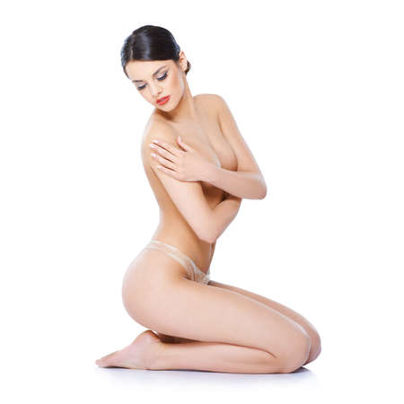 nude woman sitting: Fresh natural lady sitting isolated on white background Stock Photo