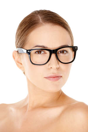 rimmed: Beautiful young woman with wearing heavy rimmed glasses looking at the camera with a serious thoughtful expression Stock Photo