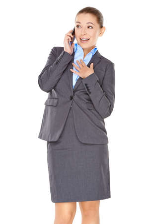 Businesswoman chatting on her mobile phone listening to the conversation and smiling while gesturing towards her chest with her hand photo