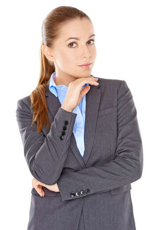 sceptical: Sceptical businesswoman standing looking at the camera with her arms folded and a confident searching look  isolated on white Stock Photo