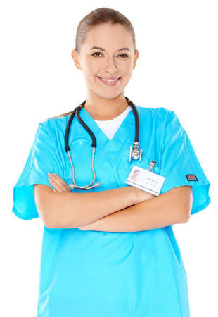 phisician: Friendly confident female doctor or nurse with a beautiful smile in green scrubs with a stethoscope around her neck  isolated on white